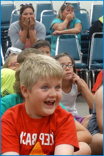 Boy Entertained at Magic Educational Show Orlando Florida